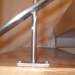 stainless steel and wooden stairwell banister