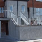 polished metal steel outdoor handrail stairwell